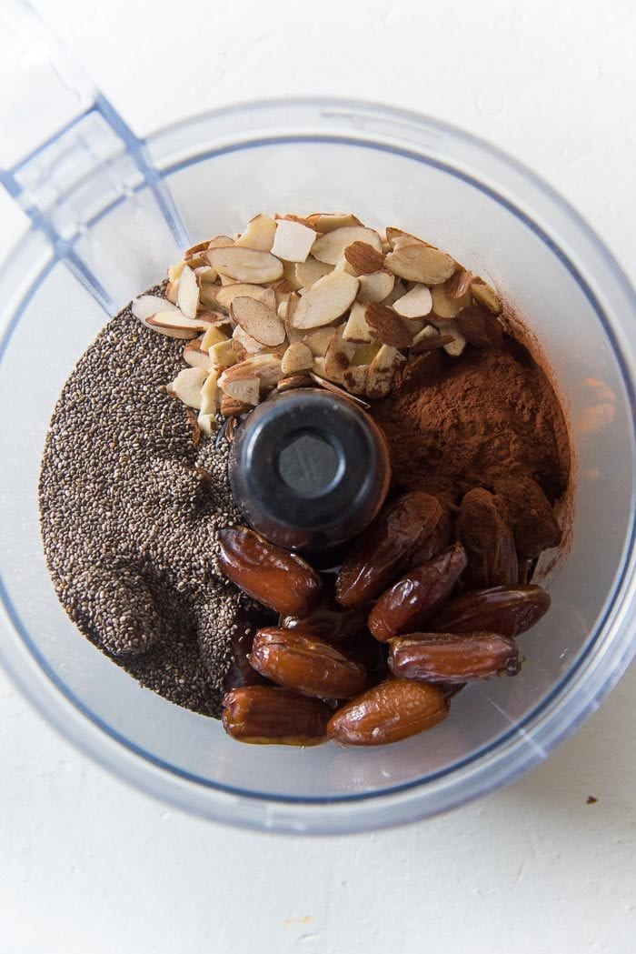 All the ingredients in the food processor bowl to make the chocolate chia bliss balls.