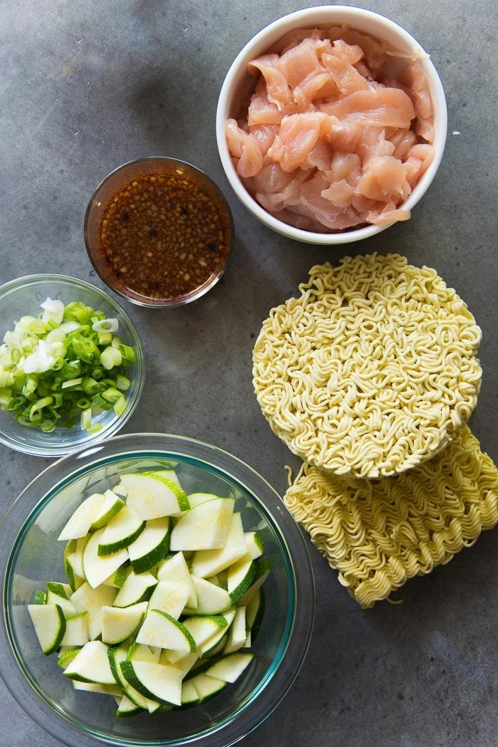 All the ingredients needed to make this 15 minute Chicken Ramen Stir Fry Noodles. From zucchini, to chicken, to the stir fry sauce, green onions and ramen noodles.