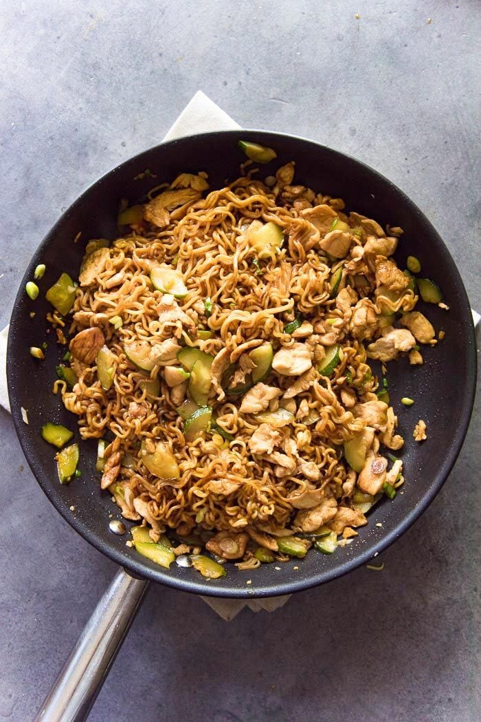 The ramen is cooked through, and then mixed with the rest of the stir fry to be coated evenly with all the flavors. The Chicken ramen stir fry noodles are ready to be eaten now.
