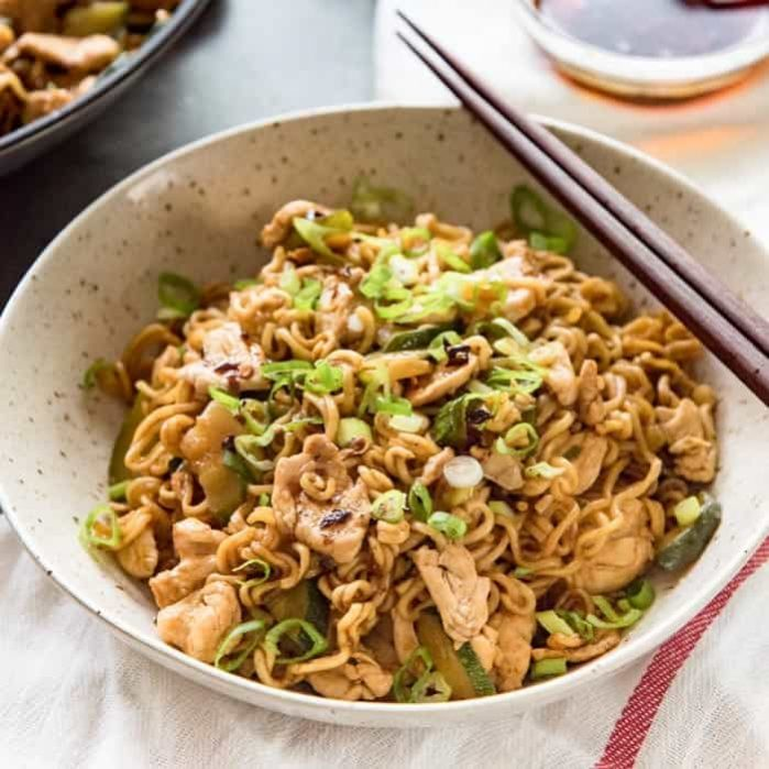 15 minute Chicken Ramen Stir Fry - A delicious way to spruce up regular instant ramen noodles without the flavor packets. It's ready in minutes, and is better for you and tastes even better! Perfect lunch or dinner for busy week days and nights and for students living on a budget.