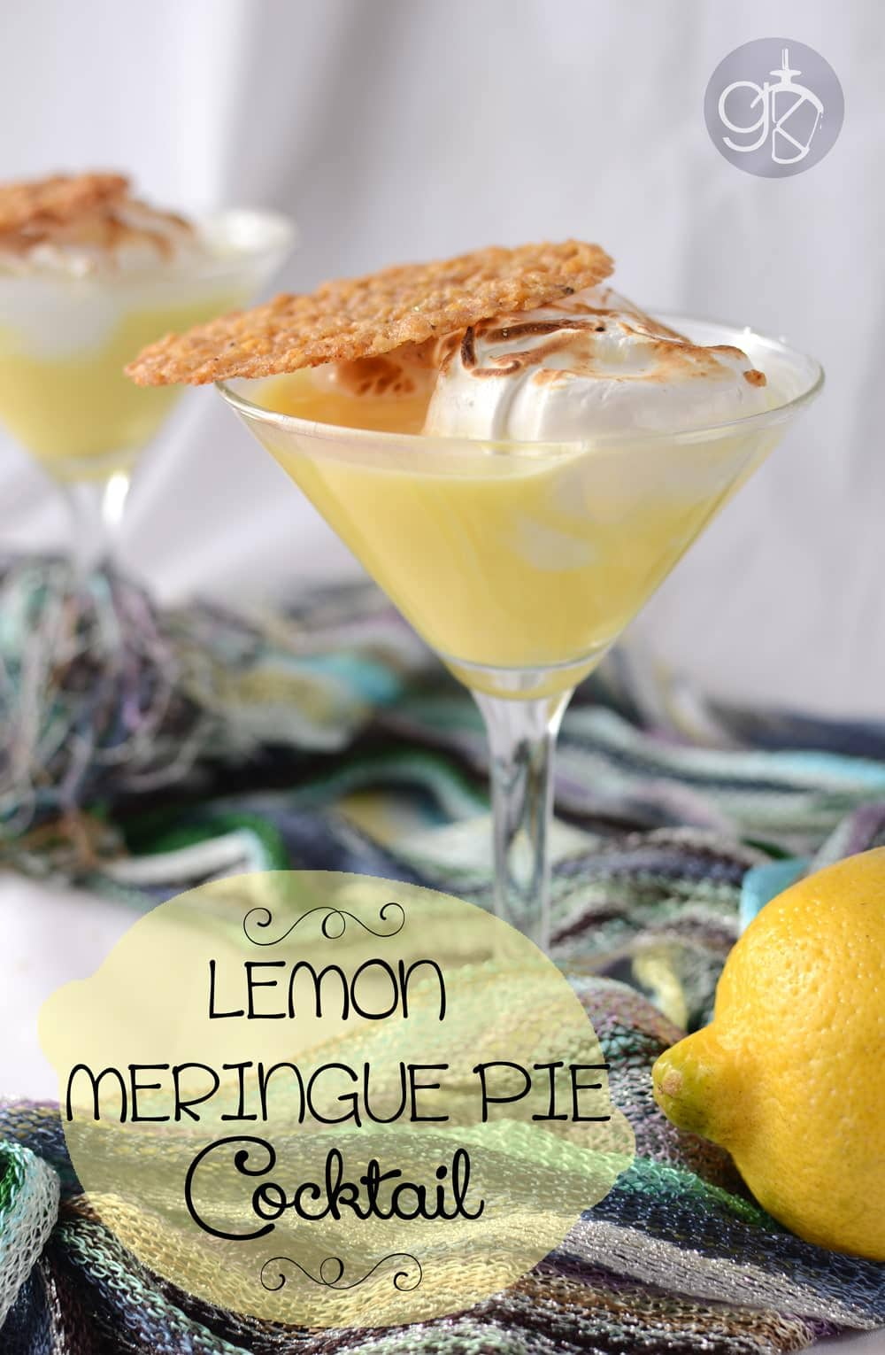 "Lemon Meringue Pie Cocktail - A fusion of a cocktail and Lemon Meringue Pie, this Lemon Meringue Cocktail is creamy, topped with a sweet meringue and a lemon and oat lace cookie ""crust""."