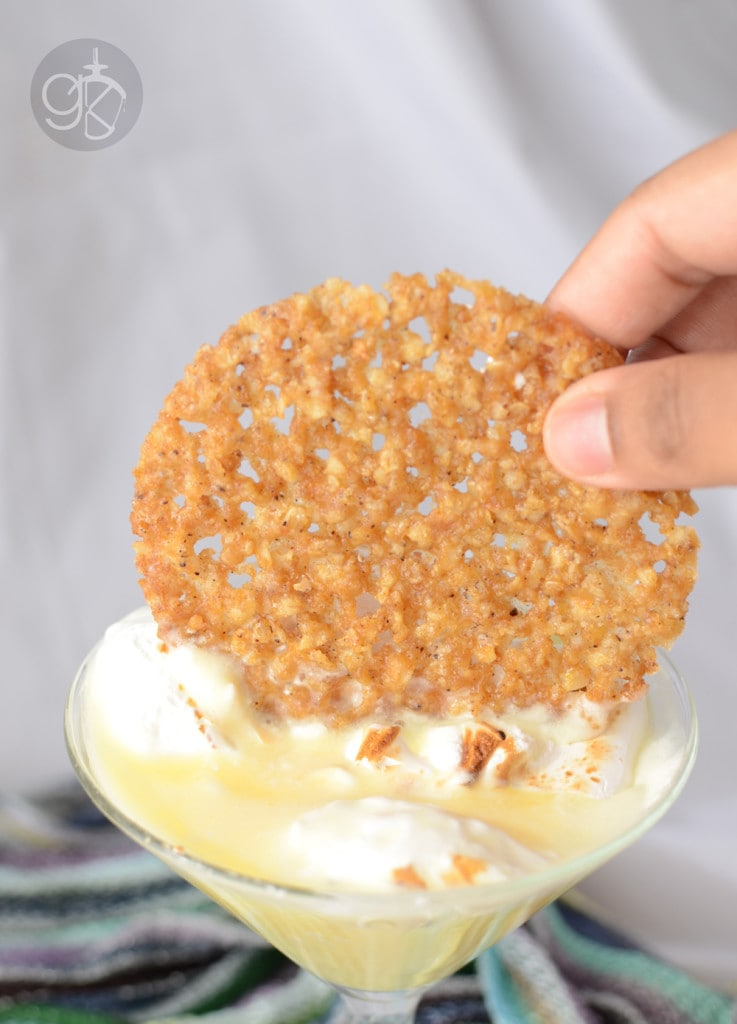 """Lemon Meringue Pie Cocktail - A fusion of a cocktail and Lemon Meringue Pie, this Lemon Meringue Cocktail is creamy, topped with a sweet meringue and a lemon and oat lace cookie """"crust""""."""