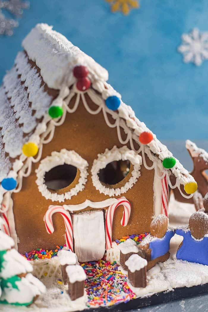 Gingerbread House - Get the perfect gingerbread dough recipe to make this adorable gingerbread house or your favorite cutout Christmas cookies! You can get your hands on this easy, printable gingerbread house template too.