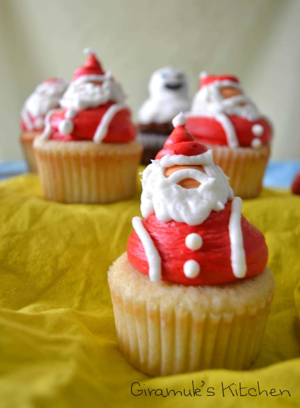Snowmen or Santa Claus Christmas Cupcakes - Make your Christmas Vanilla cupcakes filled with orange curd & with Snowman & Santa claus frosting! You can add a Doctor who theme if you are a whovian or make it your own! Full visual how-to tutorial for the frosting included in the recipe!