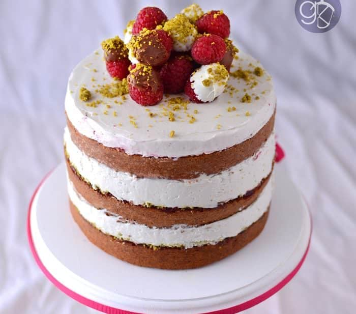 Raspberry cake with Pistachio and Rose water Swiss Meringue Buttercream.