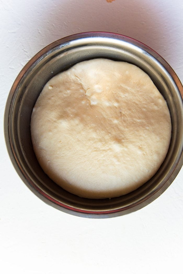 Easy Homemade Hot Dog Buns - The bread dough after an overnight proof in the fridge. The dough has doubled in size and is chilled.