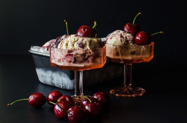 A delicious new Ice Cream for Summer! Kahlua and Cherry Ice Cream! Sweet, Cherry compote swirled through creamy ice cream spiked with Kahlua that gives it a hint of coffee. Can easily be non alcoholic by substituting the Kahlua!