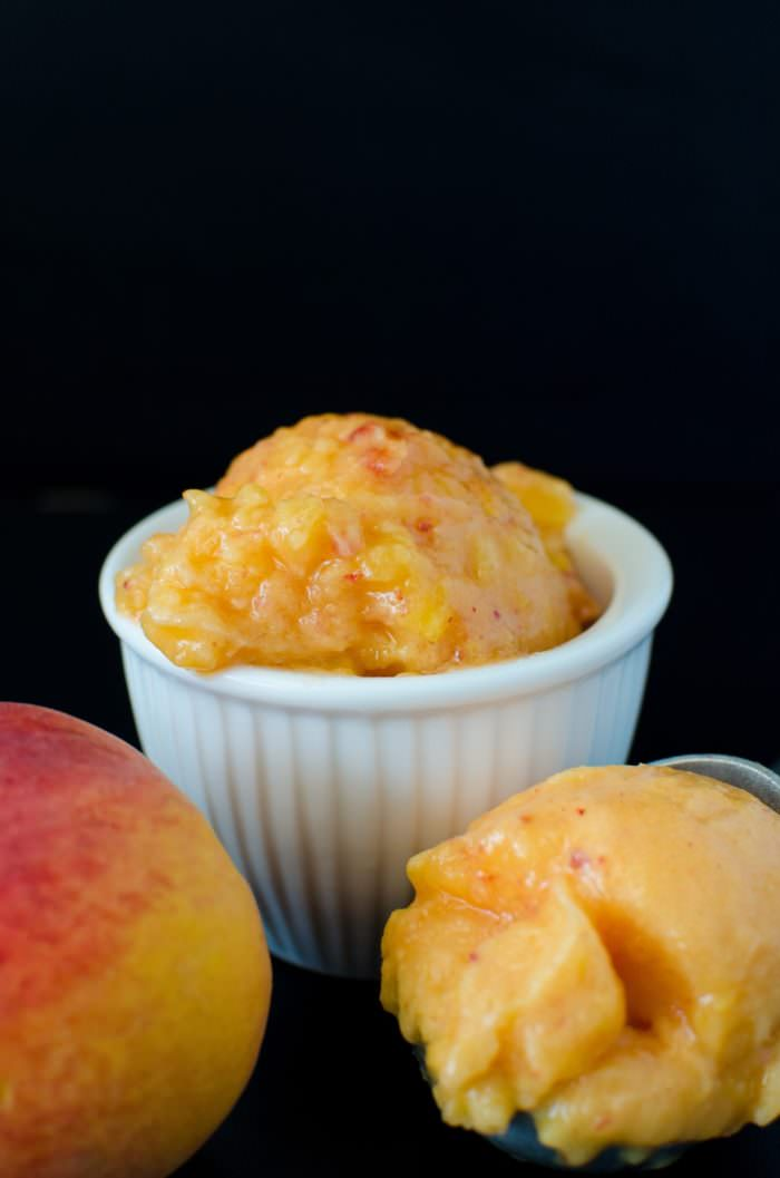 Easy Peach Sorbet - Make fruit sorbet with almost any kind of fruit any time you want! You only need 3 ingredients (not counting water)! Here are the tricks and tips to apply to your favourite fruits to make Sorbet! Raspberry Sorbet, Peach Sorbet, Honeydew Melon Sorbet, and Pineapple Sorbet!