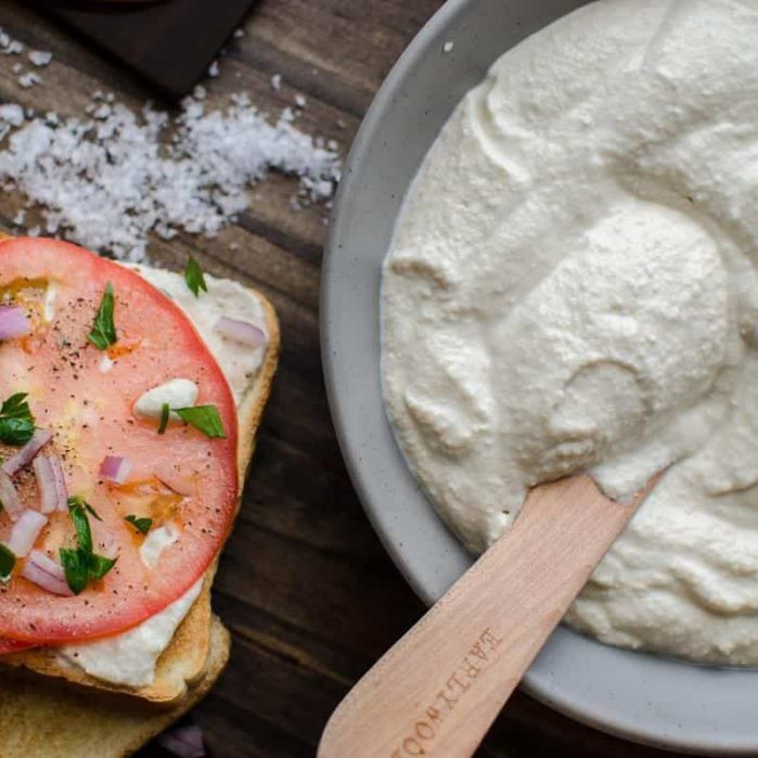 Creamy Vegan Ricotta - Made with Cashews and Tofu, this is the ricotta substitute you can use for pasta dishes, sweet dishes and even just spread on your toast for beakfast! Whether you like soft or firm ricotta, this can easily be put together in minutes and you would think this is the real deal!