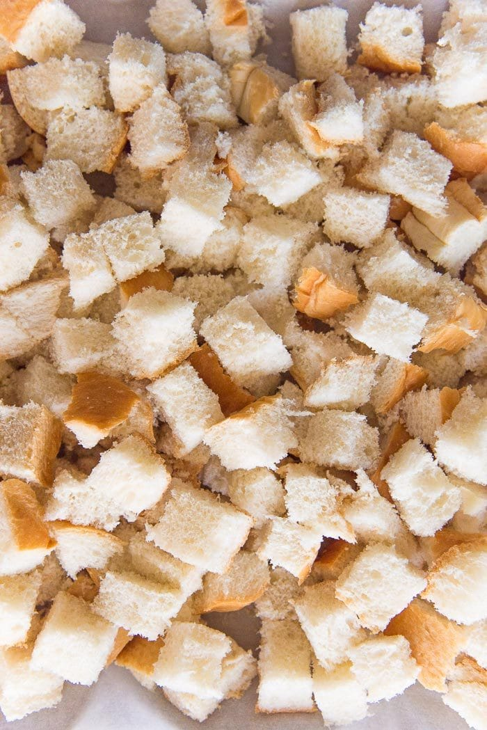 Making croutons with fresh bread. It makes the stuffing taste even better.