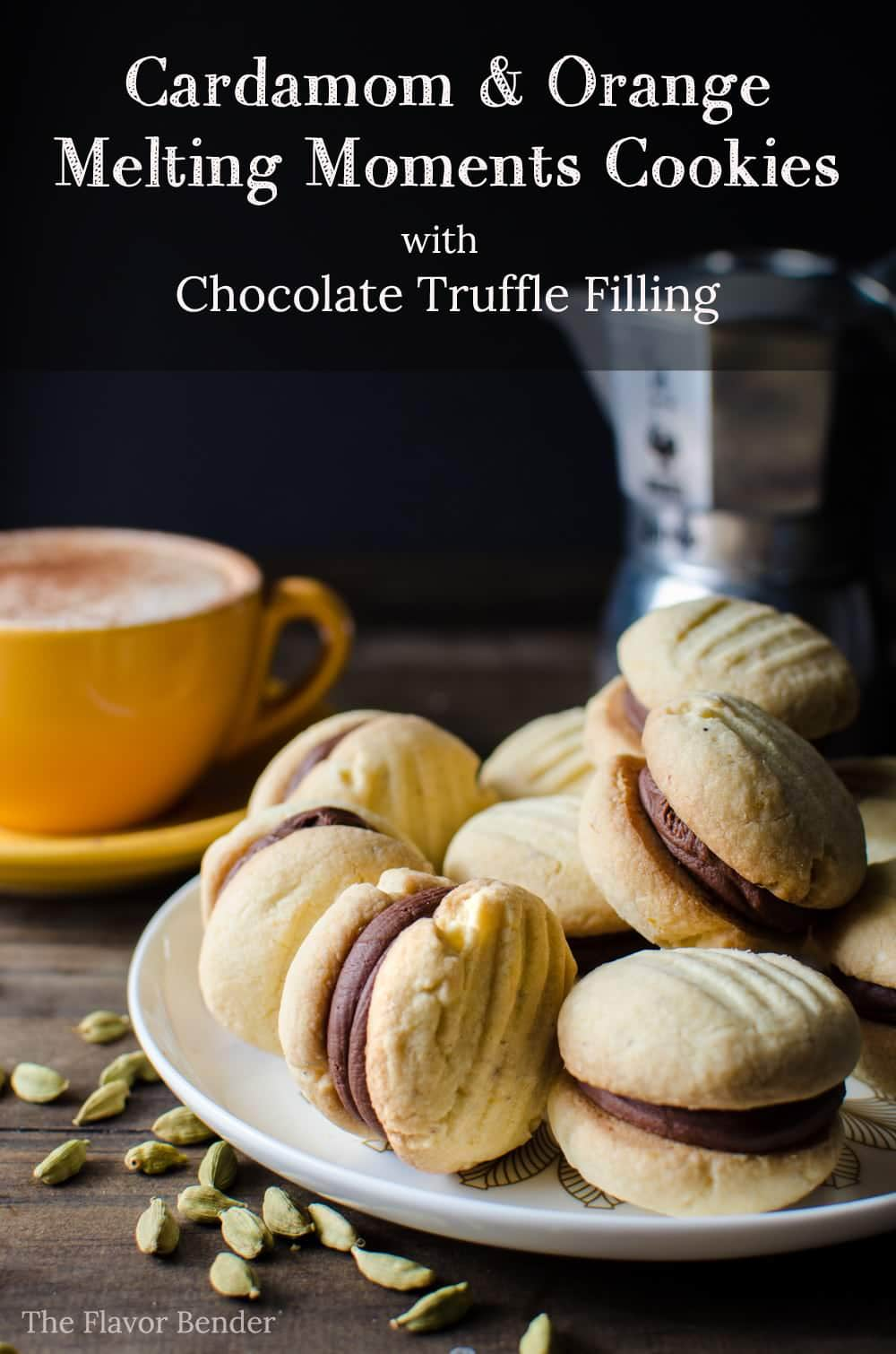 Cardamom and Orange Melting Moments Cookies with Chocolate Truffle filling - Incredibly delicious cookies that melt in your mouth! It's like the shortbread cookie's more delicate, crisper cousin. So easy to make and it will disappear in seconds!