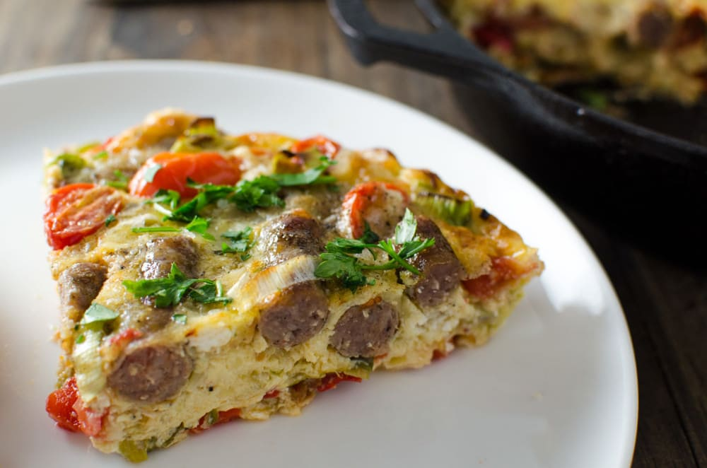Sausage Frittata with Persimmon Salsa - A luscious, creamy, flavorful Frittata studded with breakfast sausages and Bucheron goats cheese. Plus a sweet Persimmon Salsa to go with the frittata or on top of toasted French bread to make Bruschetta. This Sausage Fritta with Persimmon Salsa is quick, easy, nutritious and oh so tasty!