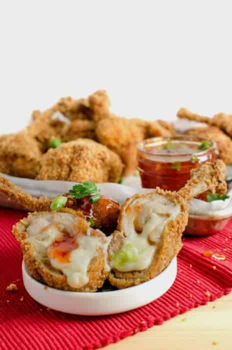 Boneless Cheese Stuffed Chicken Wings - These are no ordinary Chicken Wings! These are boneless Chicken wings STUFFED with gooey melted cheese AND Pork (or chicken)!. These Boneless Cheese Stuffed Chicken wings are indescribable and absolutely delicious!