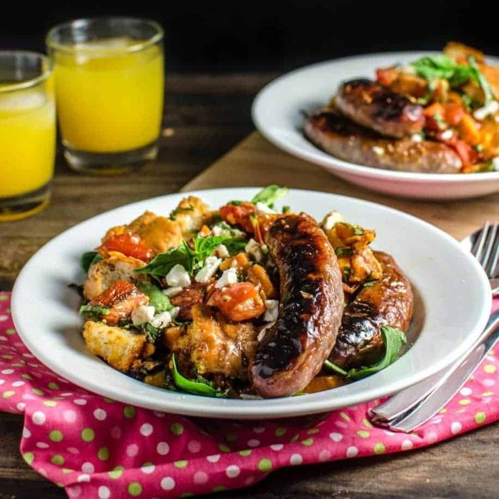 Roasted Panzanella Salad with a Balsamic Honey Mustard Dressing- with roasted Sausages, Tomatoes, Sweet potatoes, Goat cheese and Herbs is easy to make, and can be eaten warm, or at room temperature! Perfect for winter or any time of the year.