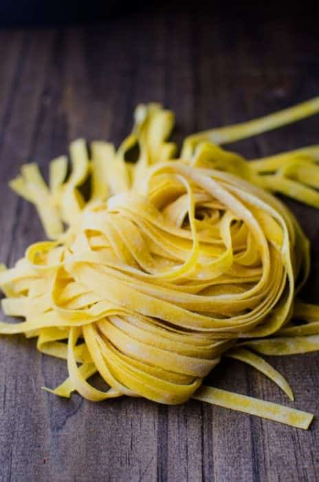 Homemade Turmeric Pasta - Bright yellow, smokey turmeric infused into homemade pasta dough. Fun to make and gives your pasta a delicious smoky flavor with a pleasant, slight bitterness.