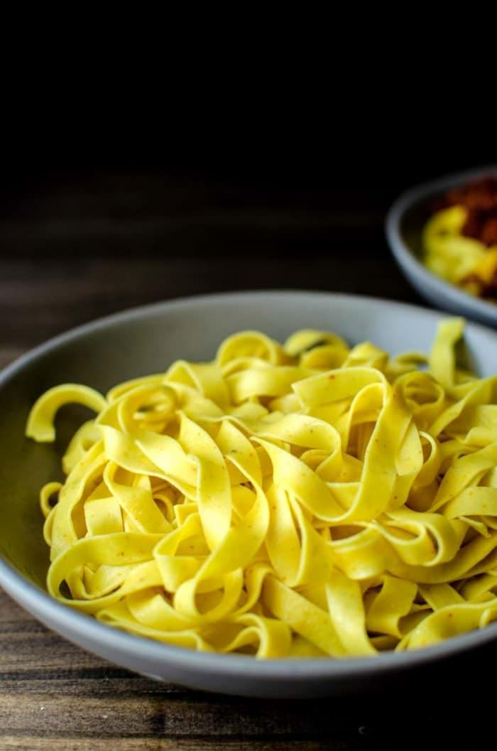 Homemade Turmeric Pasta - Bright yellow, smoky turmeric infused into homemade pasta dough. Fun to make and gives your pasta a delicious smokey flavor with a pleasant, slight bitterness.