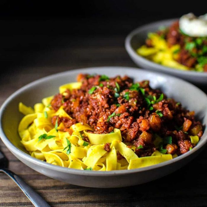 Apricot and Chorizo Bolognese - an easy dinner recipe that can be made with homemade or storebought pasta! Sweet and smoky flavors of this pasta dish will win you over in a snap!