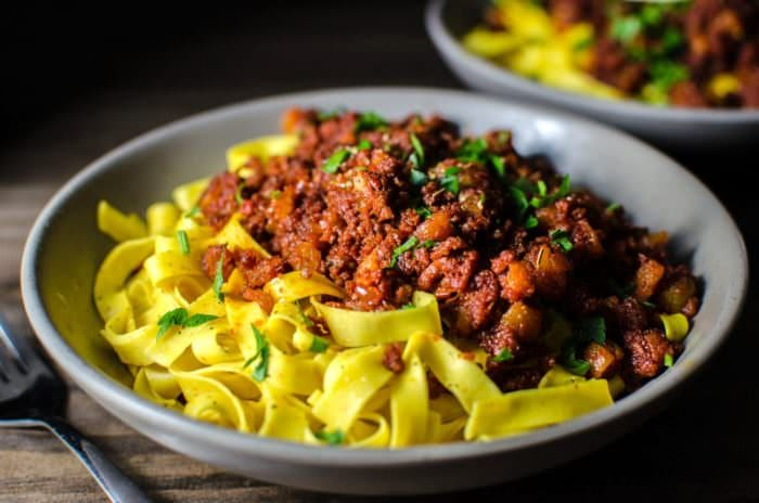 Apricot and Chorizo Bolognese - an easy dinner recipe that can be made with homemade or storebought pasta! Sweet and smokey flavors of this pasta dish will win you over in a snap!