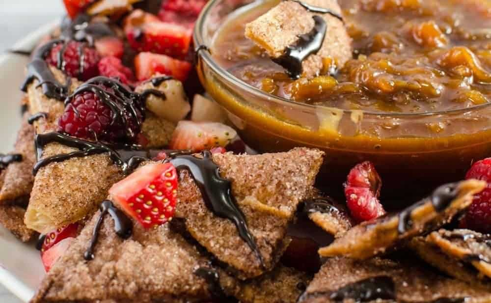Cinnamon Dessert Nachos with Salted Caramel Apple Dip (Plus Chocolate Fudge sauce and Berries) - This dessert version of Cinnamon Dessert Nachos, are taken to the next level with this decadent Salted Caramel Apple dip! But if you want the classic (or both) Just drizzle on some Chocolate Fudge sauce and berries instead