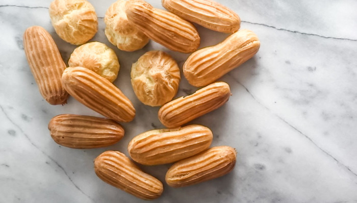 Perfect Mini Chocolate Eclairs with Coffee Creamer Creme Patissiere. Absolutely delicious, easy pastry cream made with Coffee-Mate® Chocolate Boutique Coffee Creamer, inside a perfect mini Eclair shell. #SipIndulgence with these delicious treats!