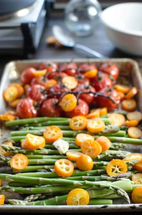 Brown Butter Vine Tomatoes, Asparagus and Kumquats - This vegetable side dish is simple and easy to make, but has big flavors! From the roasted kumqauts to the brown butter to the roasted garlic! Perfect with Salmon (or any fish), or meat!