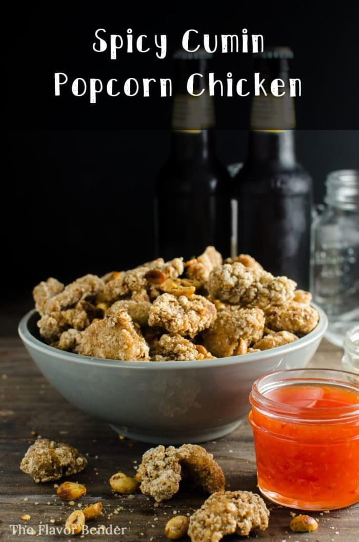 Spicy Cumin Popcorn Chicken - Deliciously marinated, crispy popcorn chicken bites, tossed with spicy cumin salt and toasted peanuts, this is the PERFECT party and game day appetizer!