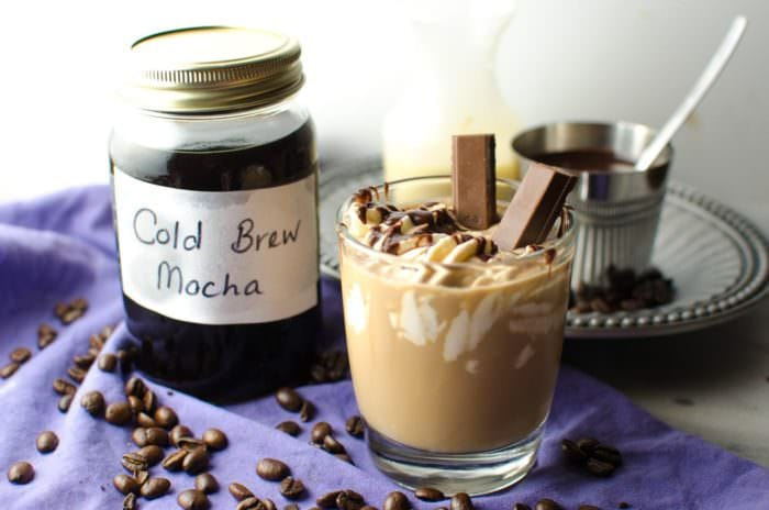 Cold Brew Iced Mocha & Kit Kat Slam - Learn how to make Cold Brew Mocha and Cold Brew Coffee and How to drink a KIT KAT SLAM! Absolutely perfect for Summer (Or anytime!) Kit Kats will never be the same again! Make your own Kit Kat Slam and tag it #TFBKitKatSlam! #TheFlavorBender CLICK to get the recipe. REPIN to save for later.
