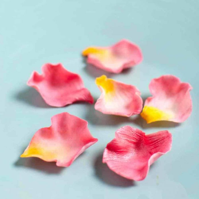 Beautiful, Fondant Rose Petals - the perfect decoration or garnish to your desserts! A full video tutorial on how to make these petals for free! CLICK to see the video. REPIN to save it! #TheFlavorBender