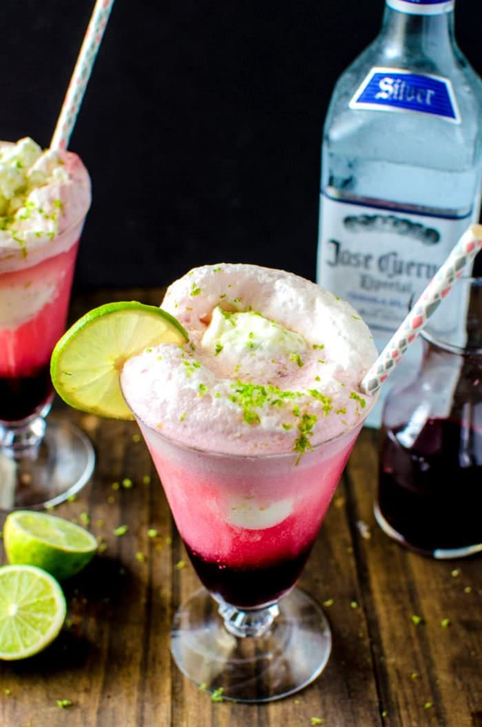 Hibiscus Strawberry Margarita Ice Cream Float - Take your Margaritas to the next level with this simple and delicious twist! Sweetened with a Hibiscus and Strawberry Syrup, plus tequila and a generous scoop of Salted Lime Sherbet this Ice Cream float is the PERFECT treat for Cinco de Mayo or any party! REPIN to save. CLICK to get the recipe! #TheFlavorBender