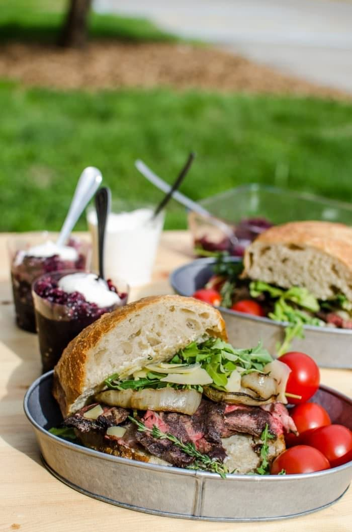 Red Wine marinated Steak Sandwiches with a Red wine Glaze, Grilled Onions, Arugula and Aged Cheddar. Red wine marinated, succulent, perfectly grilled steak, sliced and piled on toasted bread topped with a buttery red wine glaze! A Perfect Picnic Sandwich! REPIN to save. CLICK to get the recipe now. #TheFlavorBender #BlackBoxSummer [ad]