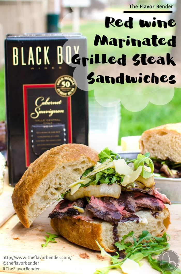 [Msg 4 21+] Red Wine marinated Grilled Steak Sandwich with a Red wine Glaze, Grilled Onions, Arugula and Aged Cheddar. Red wine marinated, succulent, perfectly grilled steak, sliced and piled on toasted bread topped with a buttery red wine glaze! A Perfect Picnic Sandwich! REPIN to save. CLICK to get the recipe now. #TheFlavorBender #BlackBoxSummer [ad]