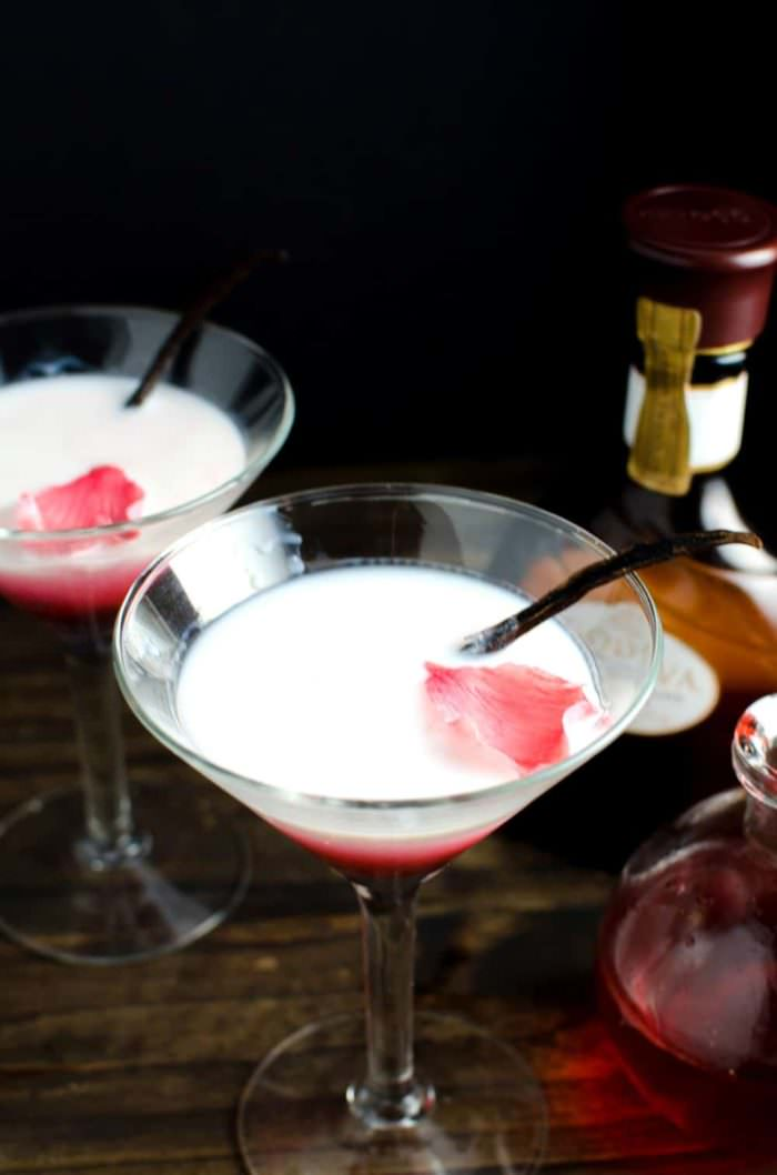 Vanilla Rose and White Chocolate Cocktail - This cocktail is one delicious, sweet decadent cocktail with beautiful floral flavours and a spectacular look! An inspired Falooda Cocktail with exotic flavours and an edible floral decoration! REPIN to save! CLICK to get the recipe now. #TheFlavorBender