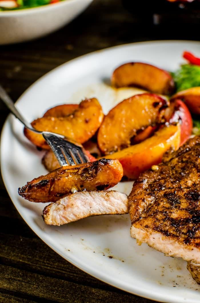 Pan Fried Five Spice Pork And Peaches - Here's your answer to an infinitely flavourful yet quick and easy, 30 minute meal! Pork chops pan fried with Five Spice powder and served with caramelized, sweet peaches! Dinner's ready in less than 30 minutes! CLICK to get the recipe. REPIN to save! #TheFlavorBender #AllNaturalPork [ad]