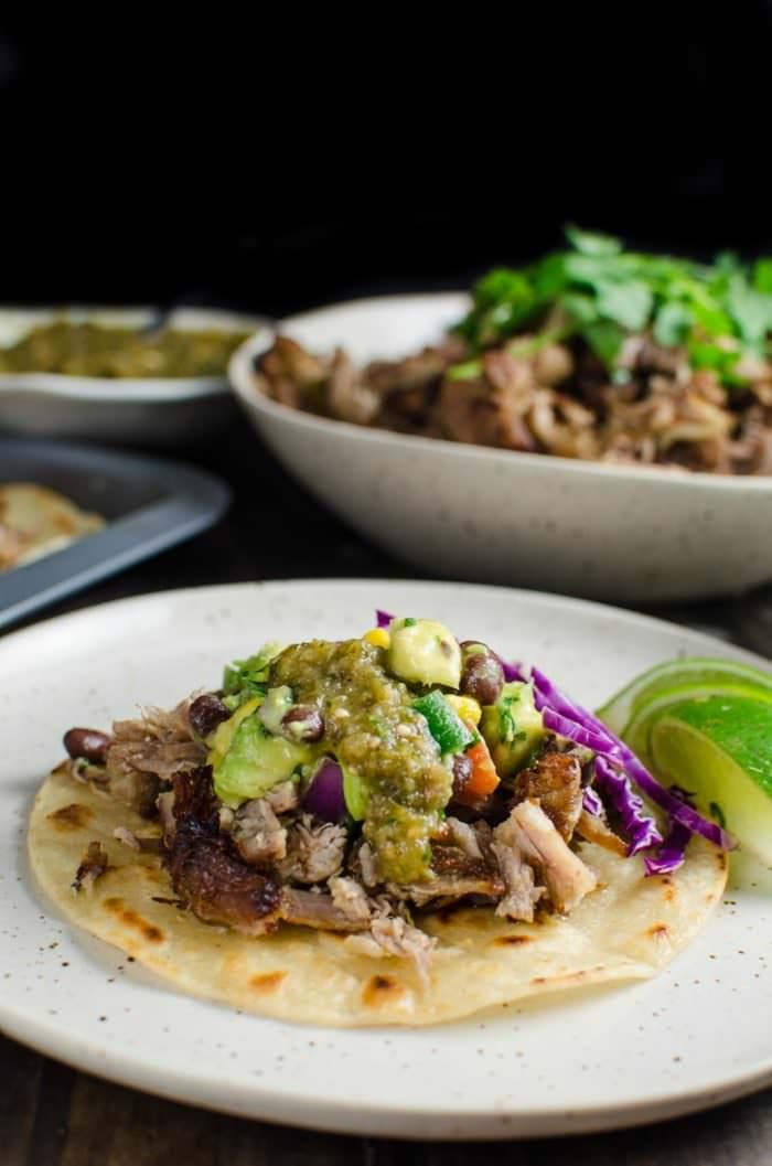 Tequila Braised Slow roasted Pork Carnitas - These Pork Carnitas have been braised in a flavor packed liquid in the oven! It is unbelievably juicy and melts in your mouth that you might not want to share it. Perfect for Tacos, Burritos, Enchiladas, Tostadas, or any Tex mex Party! REPIN for later. CLICK to get the recipe. #TheFlavorBender