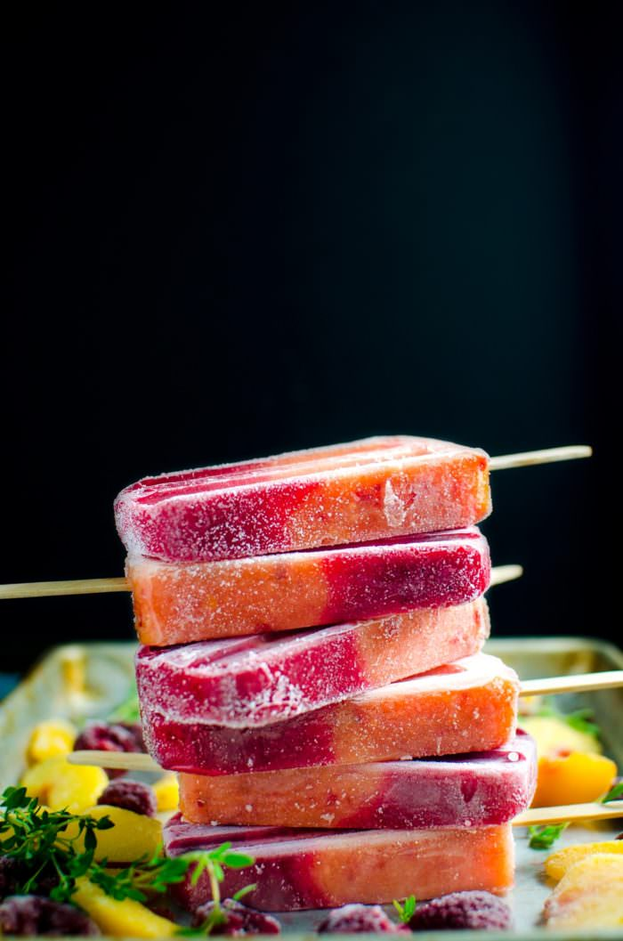 Peach Melba Popsicles (Thyme, Peach, Raspberry Popsicles) - Ripe, juicy peaches, tangy raspberries, and thyme sugar syrup come together to form the juiciest, fruitiest Peach Melba Popsicles that have SUMMER written all over them! So simple to make, so refreshing to have! SAVE for later. CLICK to get the recipe #TheFlavorBender