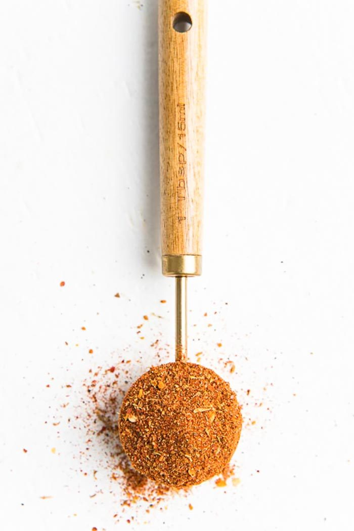 An overhead view of cajun seasoning measured in a tablespoon.