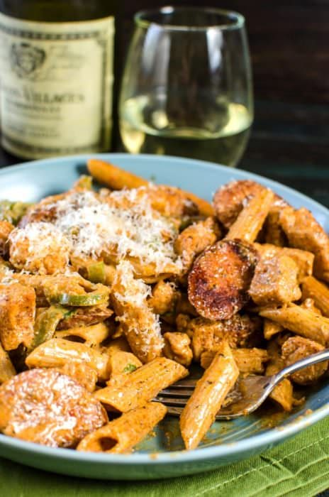 Creamy Chicken and Sausage Cajun Pasta - a spicy, herby, peppery and unabashedly flavourful, easy weeknight or weekend dinner that your whole family will love! Creamy cajun pasta with cajun-style blackened chicken and Andouille sausage. #LoveJadot