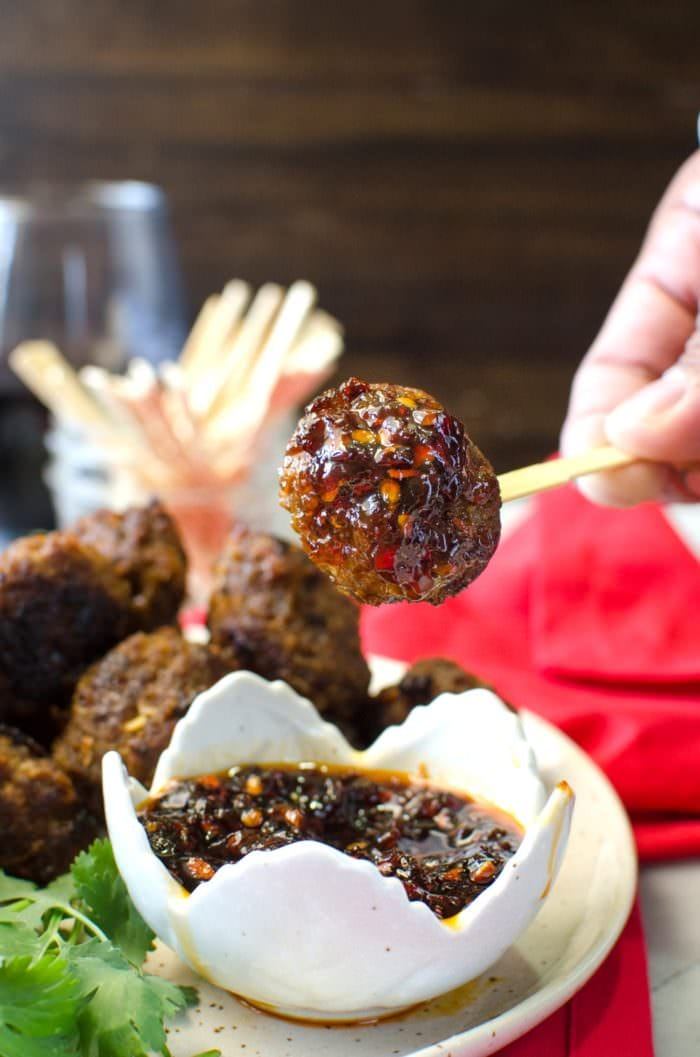 Easy Indonesian Beef Meatballs with classic sweet, spicy and umami Nasi Goreng flavors, served with a sweet and spicy dipping sauce. #TheFlavorBender