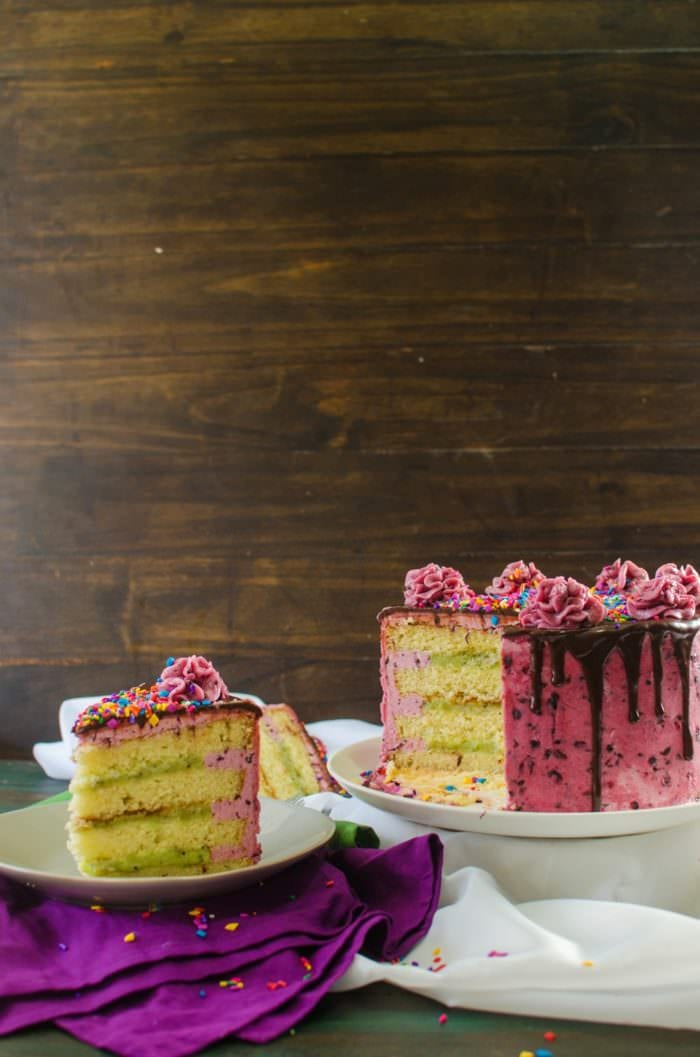 Kiwifruit Blackberry Vanilla Cake - A soft, delicious vanilla cake with a Lemon kiwifruit curd filling and a speckled blackberry buttercream frosting. A perfectcelebratorycake complete with a Video Recipe!