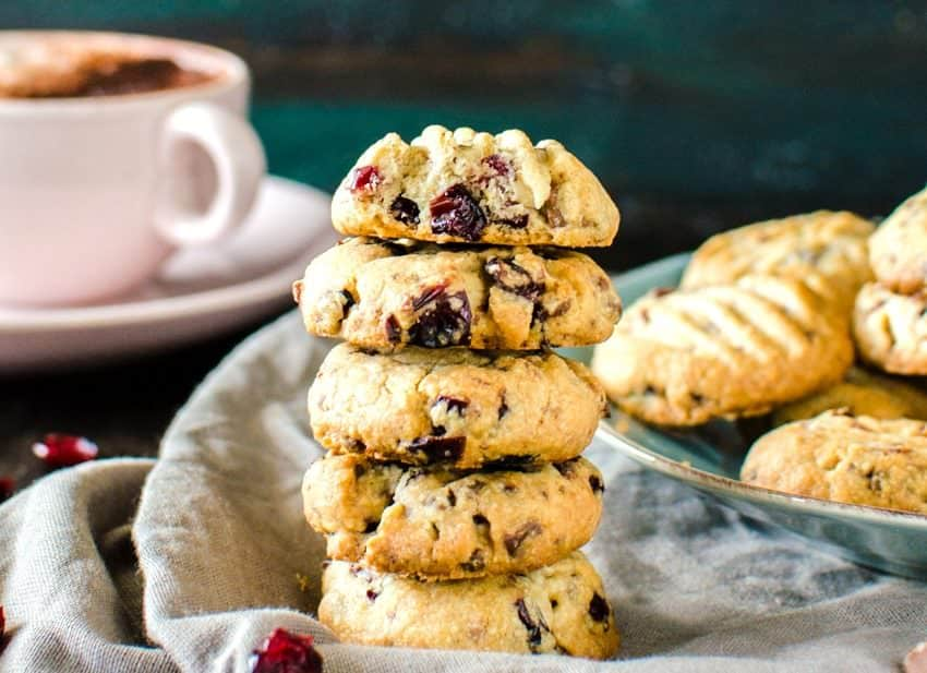 Chocolate Chip & Craisins Shortbread Cookies - Crisp, buttery, crumbly shortbread cookies, studded with bits of milk chocolate and craisins and spiced with warming spices like cinnamon, nutmeg and allspice, that are unbelievably (repeat, unbelievably!) easy to make and great for holiday baking!
