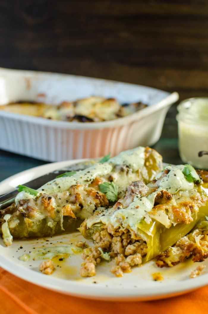 Spiced Pork Stuffed Hatch Chile - Spicy, smoky, a little sweet, a lot succulent. Incredibly delicious and super easy to make! Great way to use up hatch chiles, and if you don't have access to those, simply substitute with anaheim, poblano or even green bell peppers. This is comfort food with some amazing Mexican flavors that your whole family will love!