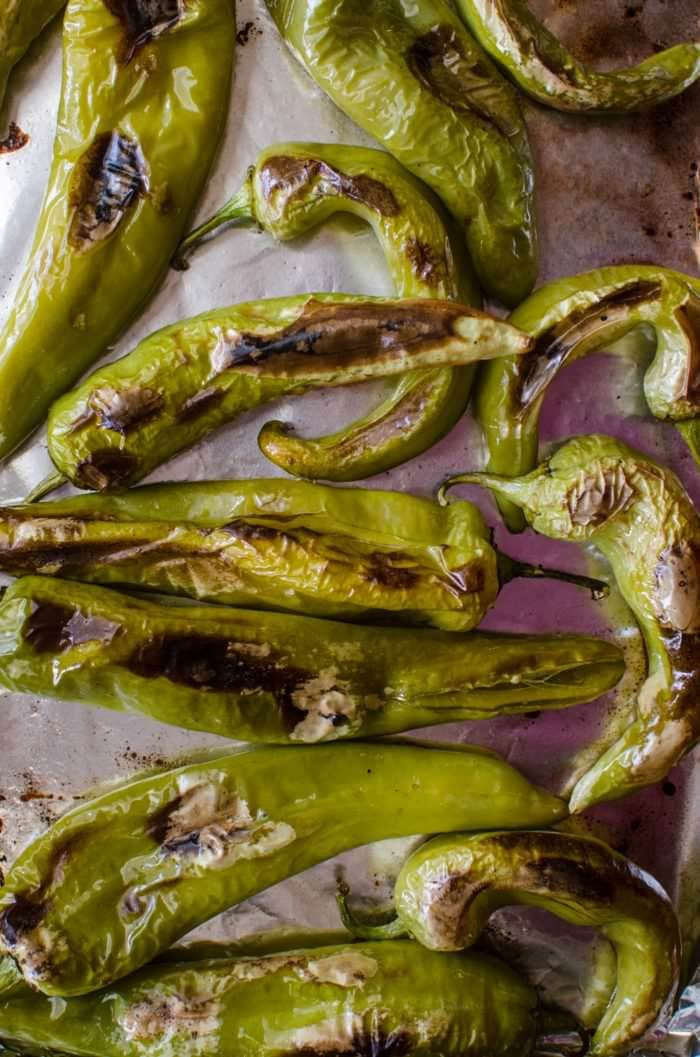 How to roast Hatch Chile at home - Get to the stores and buy Hatch Chile in bulk! You can roast them at home with this super easy guide and store them in your freezer even after they are out of season!