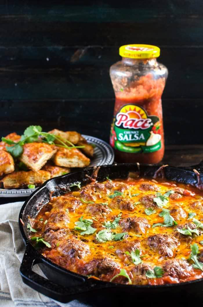Cheesy Mexican Meatball Skillet - An easy, flavor-packed one skillet meal that doubles up as a weeknight dinner that your whole family will love, or a great crowd-pleasing dish for game day or a party! Tender, spiced beef meatballs simmered in a delicious Picante Sauce and topped with gooey, melty cheese.