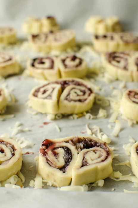 3 ingredient Berry and Cheese Palmiers - Crispy, crunchy, spicy, salty and sweet - these easy, cheesy savory palmiers are a delicious savory twist on the classic. Puff pastry, cheese and your favorite Fruit spread are all you need for this PERFECT party appetizer!
