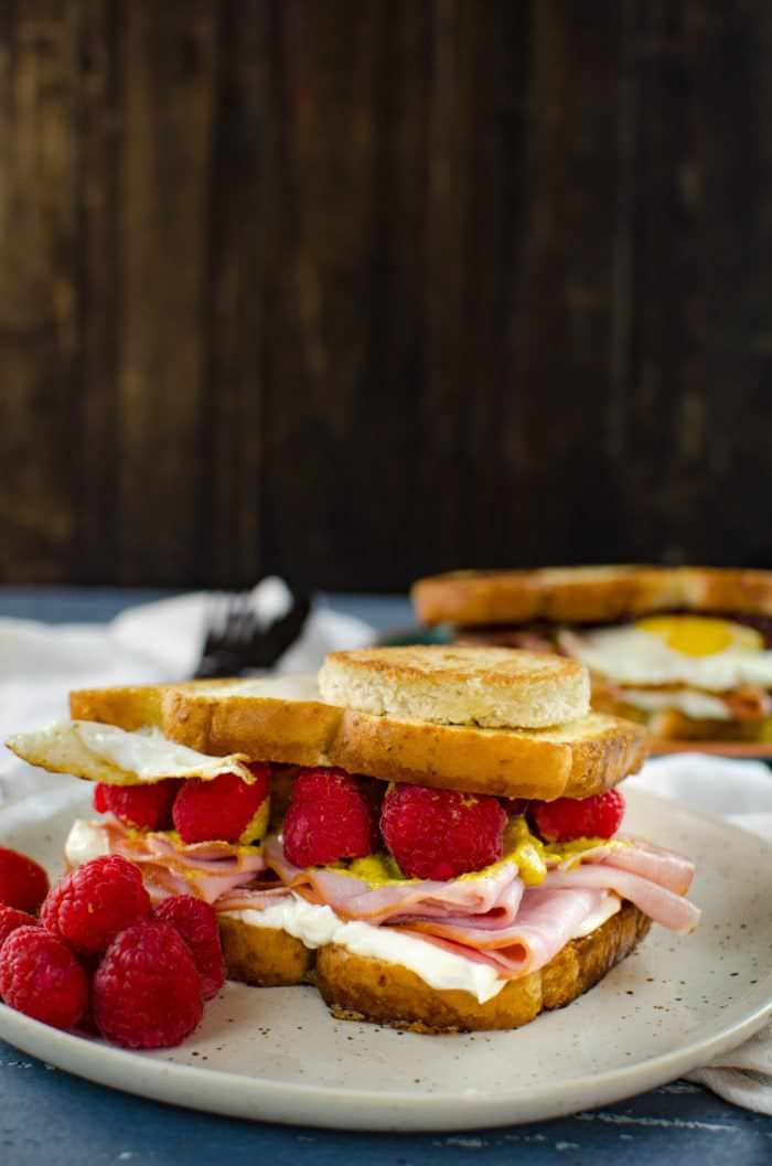 Raspberry Ham and Egg sandwich - This is the definition of a happy sandwich! Creamy with a touch of sweetness, fruity freshness and an egg cooked right into a slice of toast. A twist on a Monte Cristo Sandwich with just 6 ingredients.