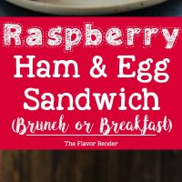 Raspberry Ham and Egg sandwich - This is the definition of a happy sandwich! Creamy with a touch of sweetness, fruity freshness and an egg cooked right into a slice of toast. A twist on a Monte Cristo Sandwich with just 6 ingredients