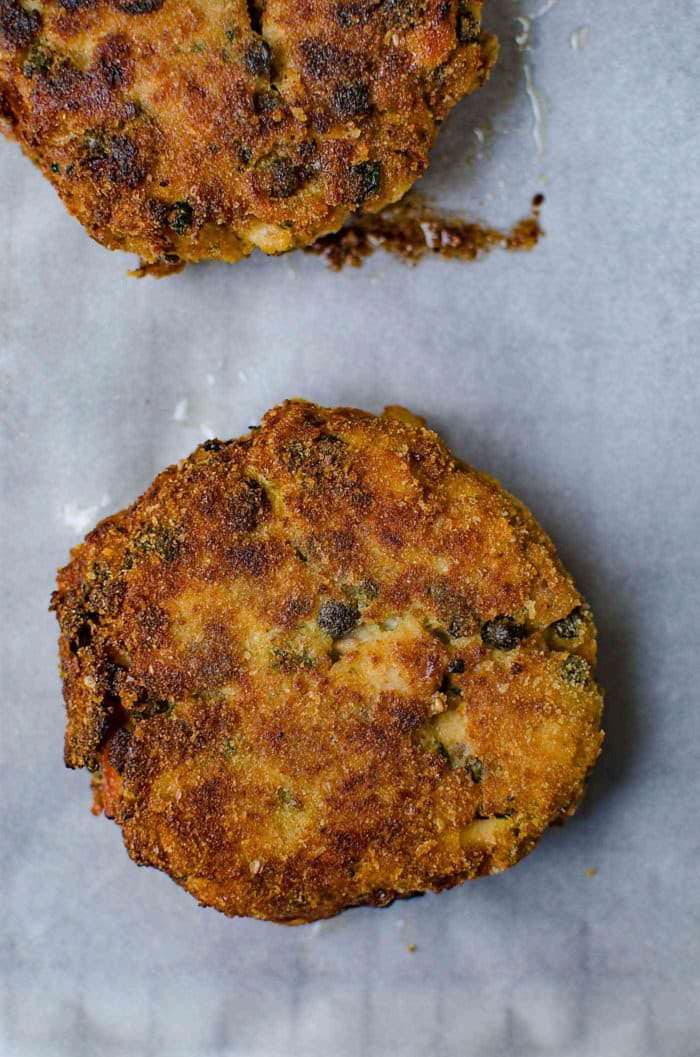 Crispy Tuna Burger with Lemon and Capers - Tuna patties just pan fried. Because they are flaky, the patties are very delicate.