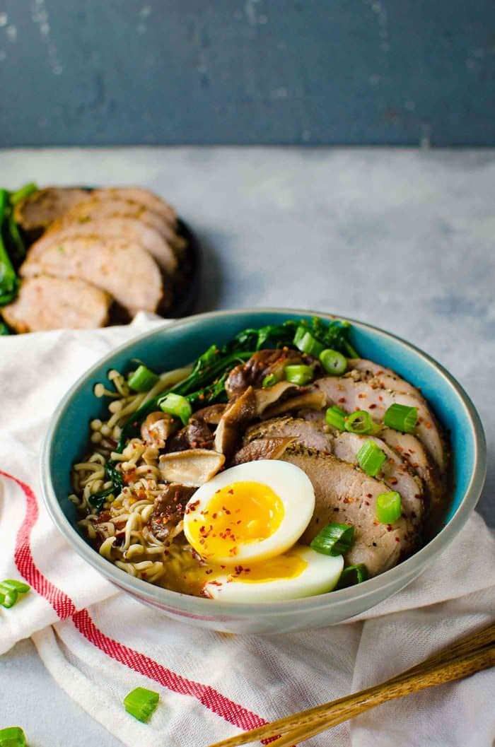 Easy Pork Ramen - Thinly sliced, perfectly cooked, juicy pork tenderloin and an egg with a gloriously runny egg yolk, crunchy Asian greens, and flavorful mushrooms, all swimming in a scrumptious and flavor-packed ramen noodle broth. All in less than 30 minutes!
