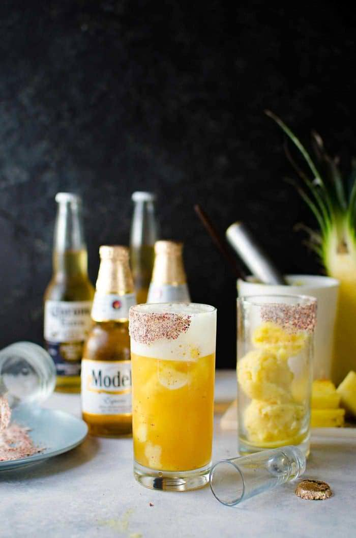 Frozen Pink Peppercorn Pineapple Margarita Shandy - The ULTIMATE summer cocktail, perfect for Cinco de Mayo! Pineapple and Pink Peppercorn sorbet with tequila and Modelo. A delicious twist on a Beer cocktail.