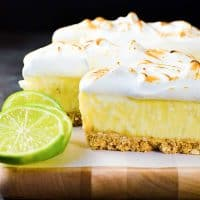 No Bake Frozen Margarita Pie Slice with a Pretzel crust - A boozy and refreshing summer dessert with perfectly balanced sweet, tart and salty flavors. Made with lime curd, and tequila this is a cocktail, a dessert and a summer fiesta in one glorious frozen margarita pie slice! And it's deceptively easy to make too!